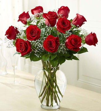 long stem red roses in glass  vase