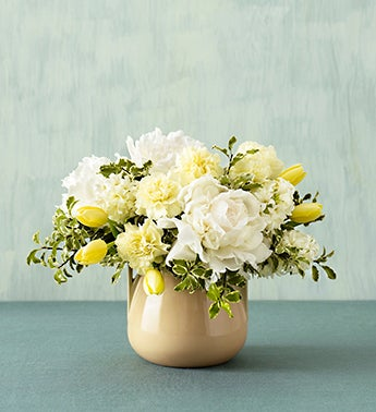 cream blossom bouquet in arts and crafts bowl