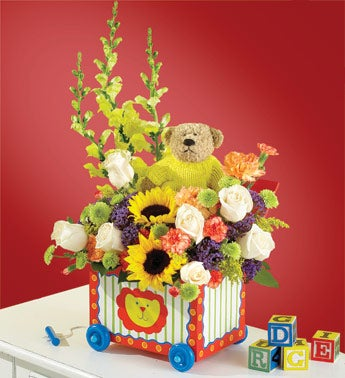 sunflower and rose arrangement with plush on wagon