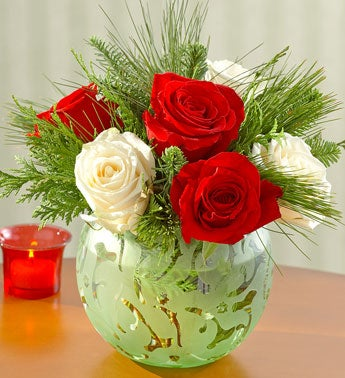 red and white roses in green glass bowl