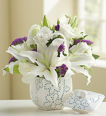 lilies, lisianthus in ceramic daisy dot container