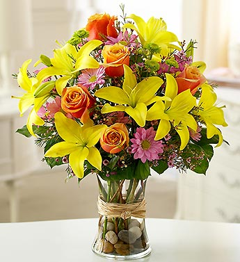 mixed lily bouquet in clear vase