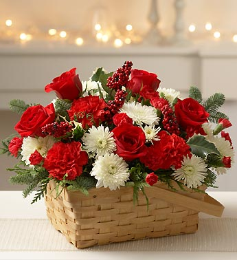 basket with carnations, roses, poms, evergreens